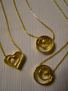 Assorted gold chains with pendants #