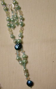 Soft pearl and teal with crystals #?