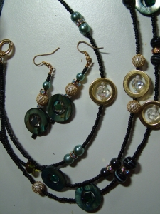 Black beads with various stones, pearls, crystals necklace and earring set.