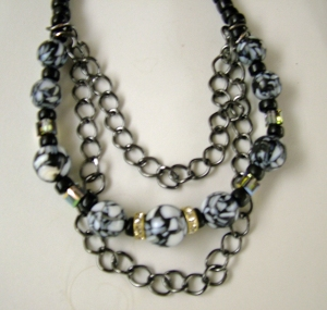 Black and white stones on chains