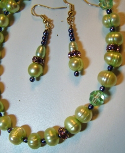 Soft green seed pearls with crystals in gold colour setting