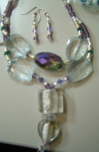 Clear and purple crystals and stones. Necklace and earring set #