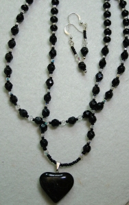 Black beads with crystal and heart necklace and earring set #