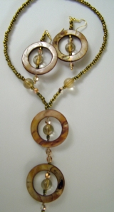 Gold beads with shell circles, necklace and earring set